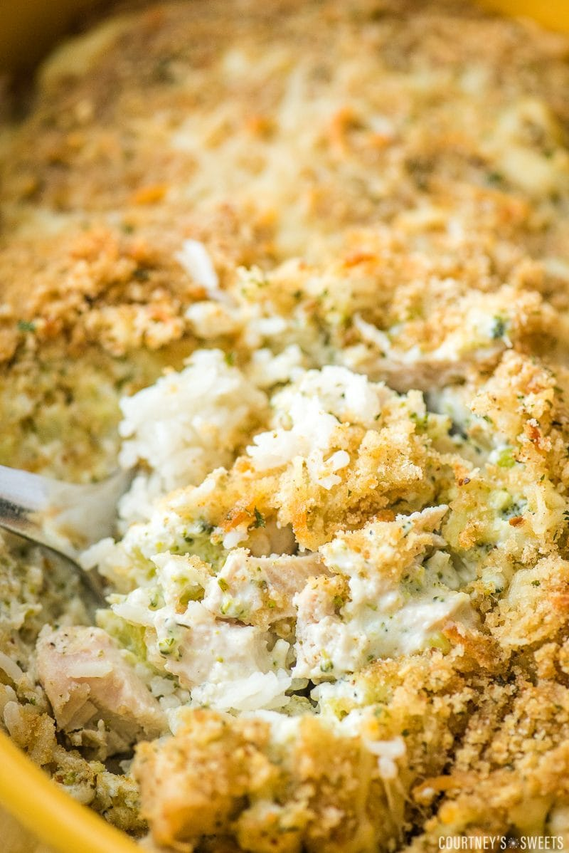 chicken broccoli rice casserole in a yellow baking dish