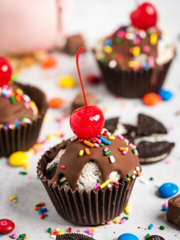 ice cream cupcakes with cherries on top