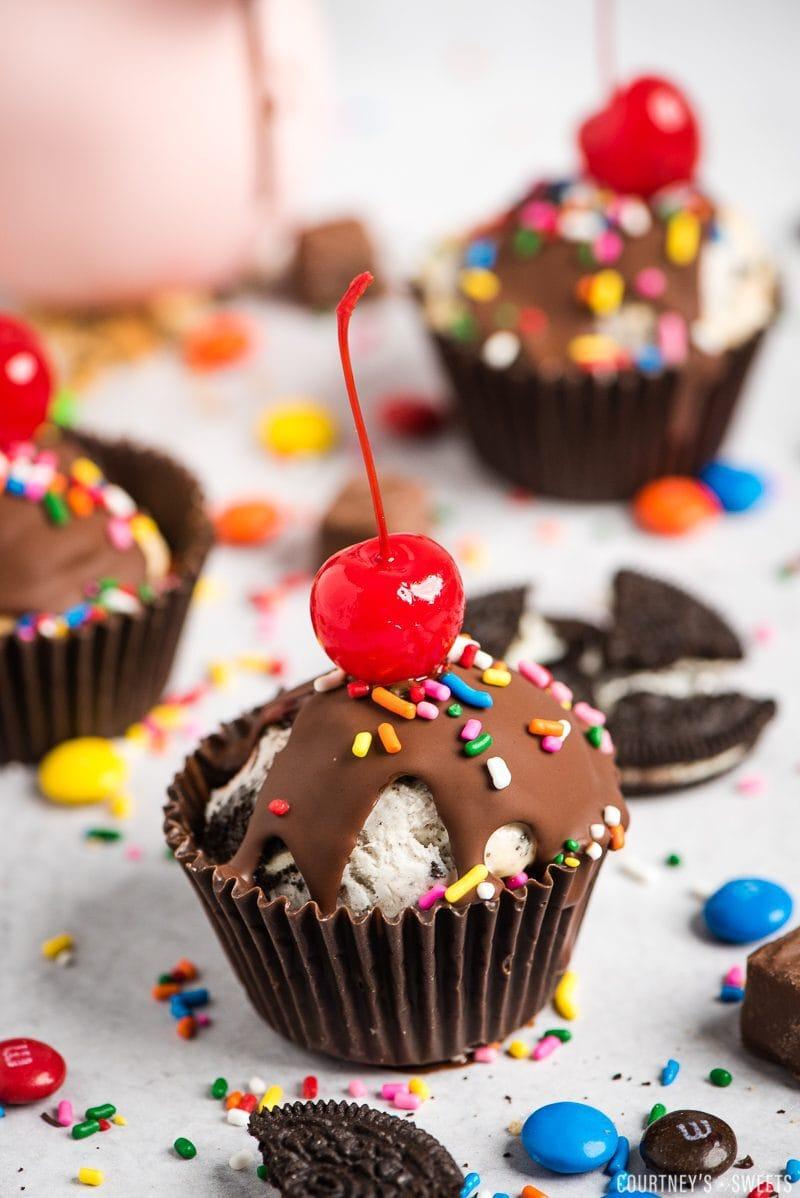 4 ice cream cupcakes with cherries on top