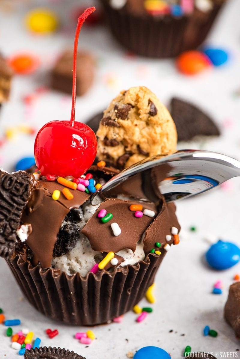 10 cracking magic shell topping with spoon on ice cream cupcake