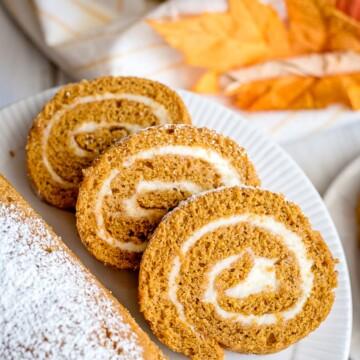 pumpkin roll sliced on a plate