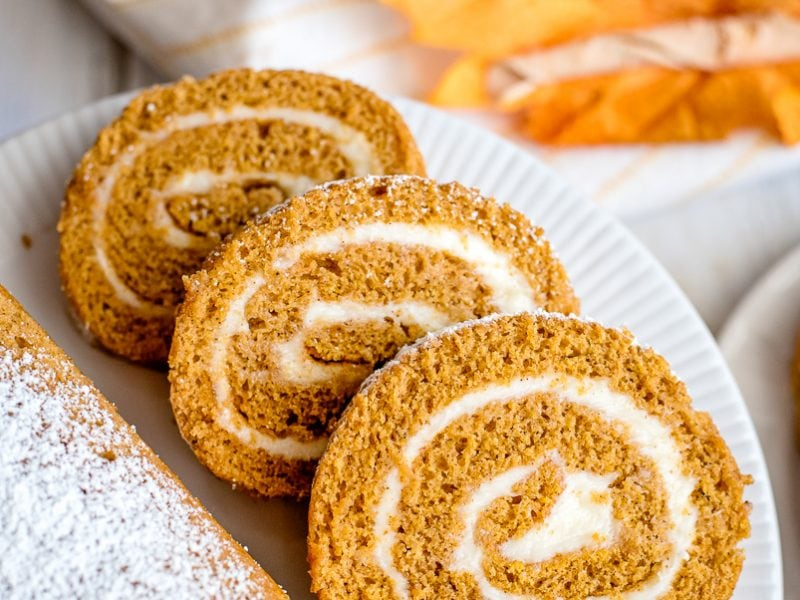 pumpkin roll sliced on a plate