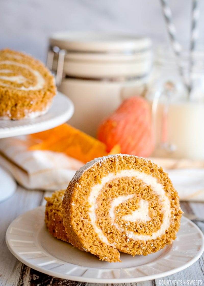 pumpkin roll slices on a plate with props in background
