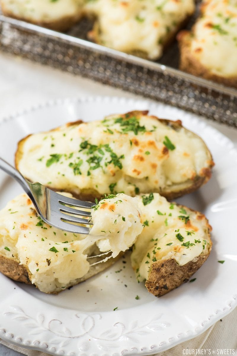 air fryer twice baked potato cut open and on fork