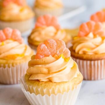 orange buttercream frosting on orange cupcakes