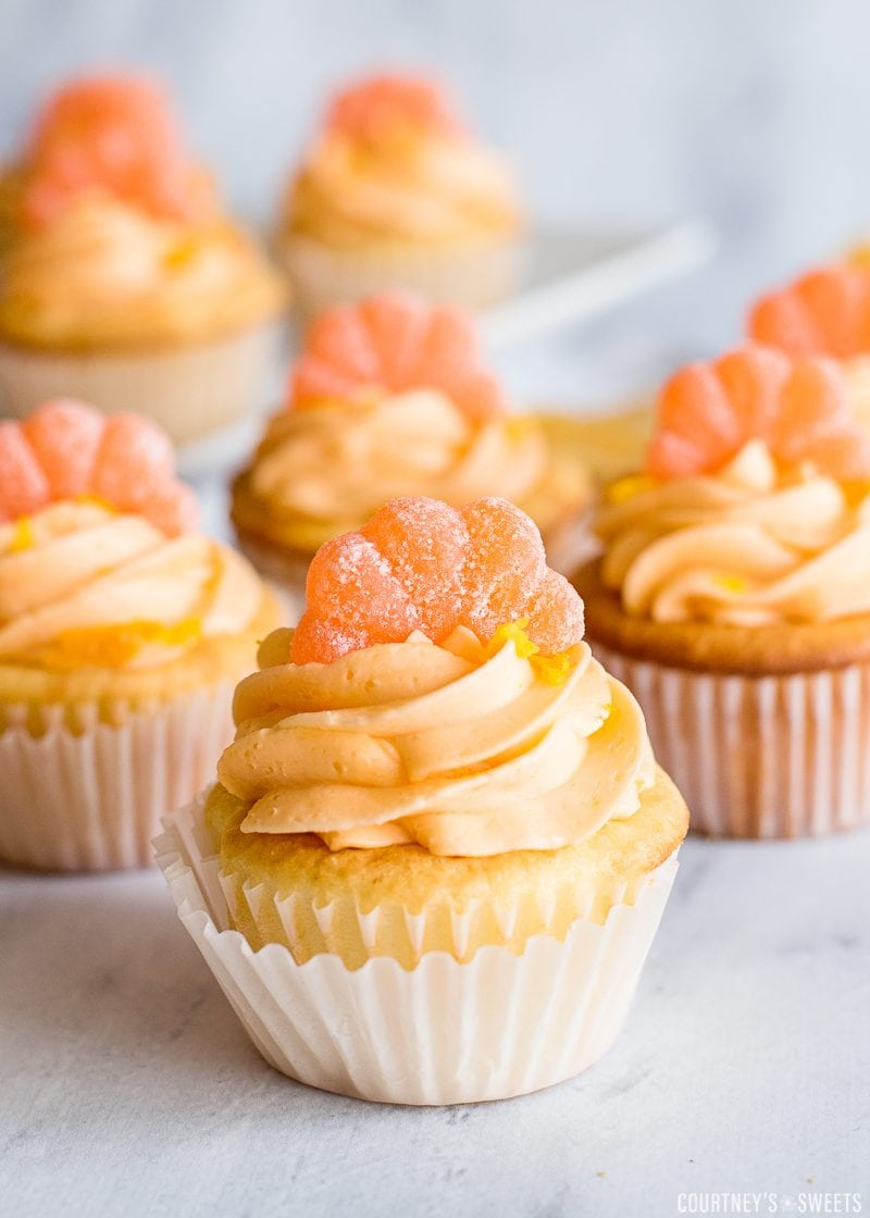 orange buttercream frosting on orange cupcakes