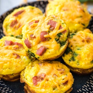 cheesy breakfast muffins on a plate