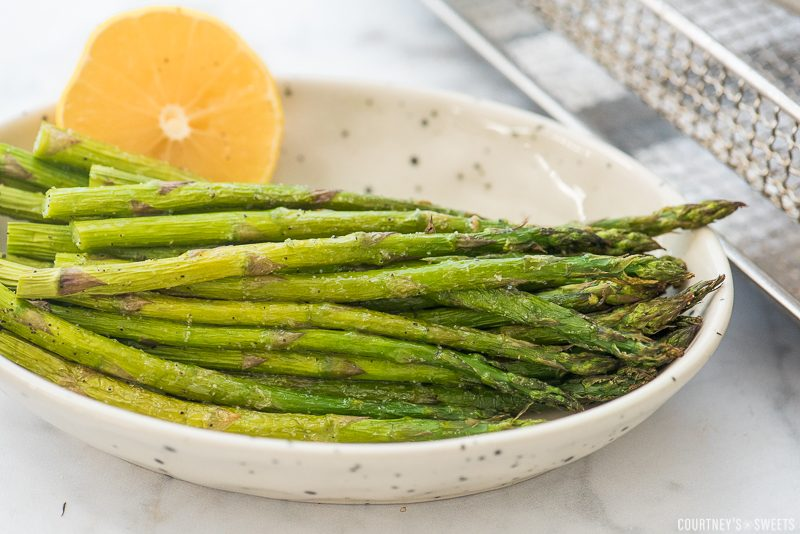 roasted asparagus with lemon in a bowl