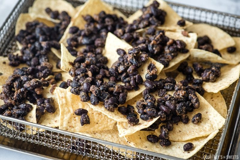 tortilla chips and black beans in air fryer rack