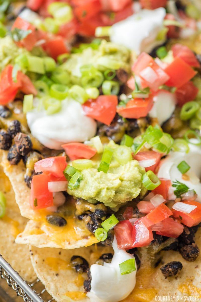nachos with black beans pico de gallo guacamole sour cream and green onions