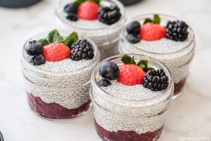 chia seed pudding in a glass jar with fresh berries