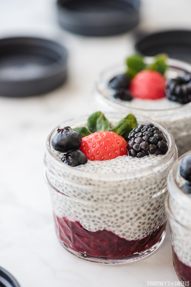 chia seed pudding in a glass jar with berries