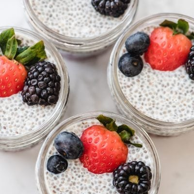 chia seed pudding with berries in meal prep jars